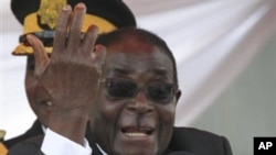 FILE- In this Sunday, March, 27, 2011, file photo, Zimbabwean President Robert Mugabe addresses mourners at a state funeral in Harare. According to South African ruling party African National Congress (ANC) mediators who are negotiating constitutional ref