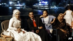 Egyptian couples celebrate their wedding party at a bridge over the Nile in Cairo (file photo)
