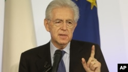 talian Premier Mario Monti gestures as he speaks during a news conference in Rome, December 23, 2012.