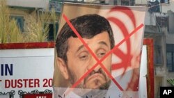 "A poster protesting the upcoming visit to Lebanon by Iranian President Mahmoud Ahmadinejad at a street advertising billboard, with words reading:"" Rule of the clergy not welcome in Lebanon,"" Tripoli, 07 Oct 2010"