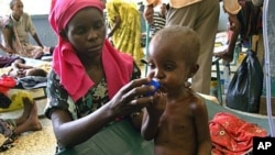 A severely malnourished Somali child receives Oral Rehydration Salts at Mogadishu's Banadir hospital on July 28, 2011