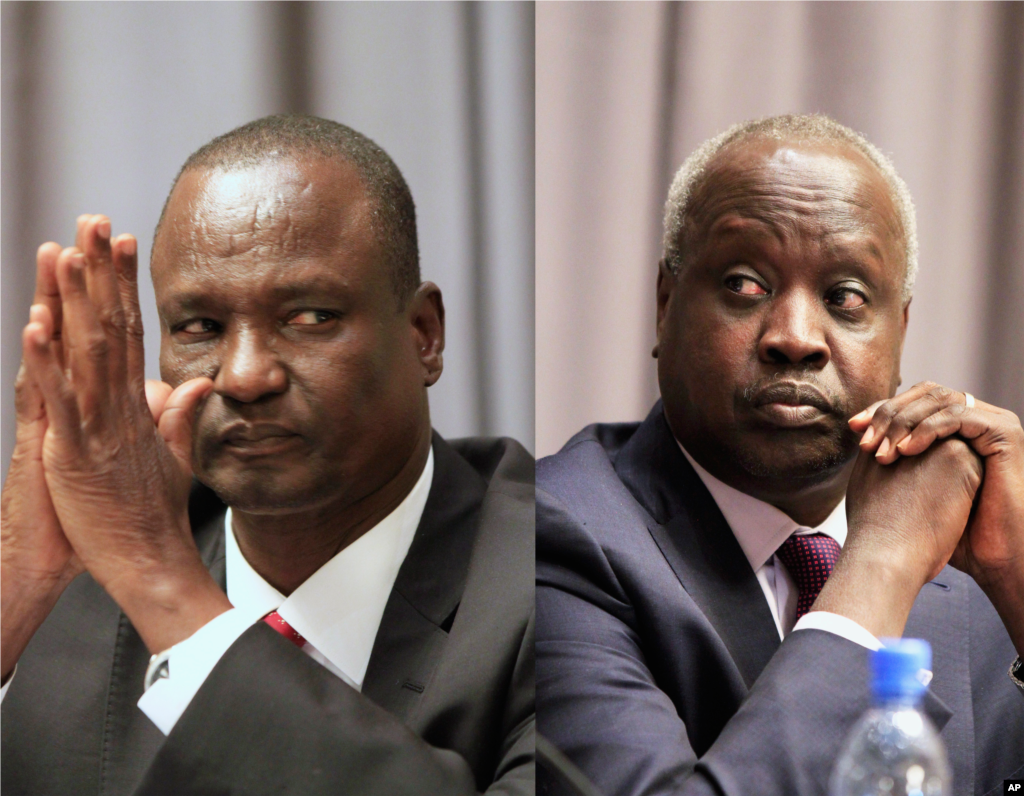 Taban Deng Gai, left, head of the rebel delegation and South Sudan's leader of the government delegation, Nhial Deng Nhial, attend the opening ceremony of South Sudan's peace negotiations, Addis Ababa, Ethiopia, January 4, 2014.