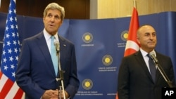 Turkey's Minister of Foreign Affairs Mevlut Cavusoglu, right, and U.S. Secretary of State John Kerry speak to the media before a meeting in Ankara, Sept. 12, 2014.
