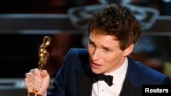 "Actor Eddie Redmayne accepts the Oscar for best actor for his role in ""The Theory of Everything"" during the 87th Academy Awards in Hollywood, California, Feb. 22, 2015."