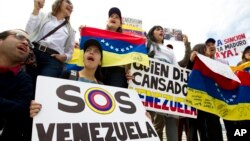 FILE - Demonstrators who are against the Venezuelan government chant outside of the Organization of American States (OAS) during the special meeting of the Permanent Council, in Washington, April 3, 2017, to consider the recent events in Venezuela.
