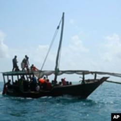 A Zanzibar fishing vessel carries the survivors of the ferry crash ashore, Tanzania, September 10, 2011.