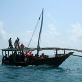 A Zanzibar fishing vessel carries the survivors of the ferry crash ashore, Tanzania, September 10, 2011.