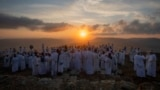 Members of the ancient Samaritan community attend the pilgrimage for the holiday of the Tabernacles or Sukkot at the religion's holiest site on the top of Mount Gerizim, near the West Bank town of Nablus, early Wednesday, Oct. 20, 2021. (