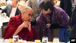 Valerie Jarrett, senior adviser to President Barack Obama, right, talks with the Dalai Lama during the National Prayer Breakfast in Washington