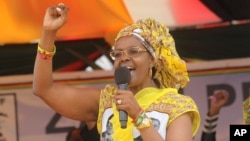 Zimbabwe's First Lady Grace Mugabe addresses party supporters at a rally in Harare, Thursday, Nov. 19. 2015