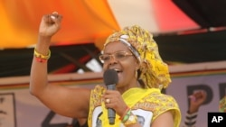 FILE: Zimbabwe's First Lady Grace Mugabe addresses party supporters at a rally in Harare, Thursday, Nov. 19. 2015. (AP Photo/Tsvangirayi Mukwazhi)