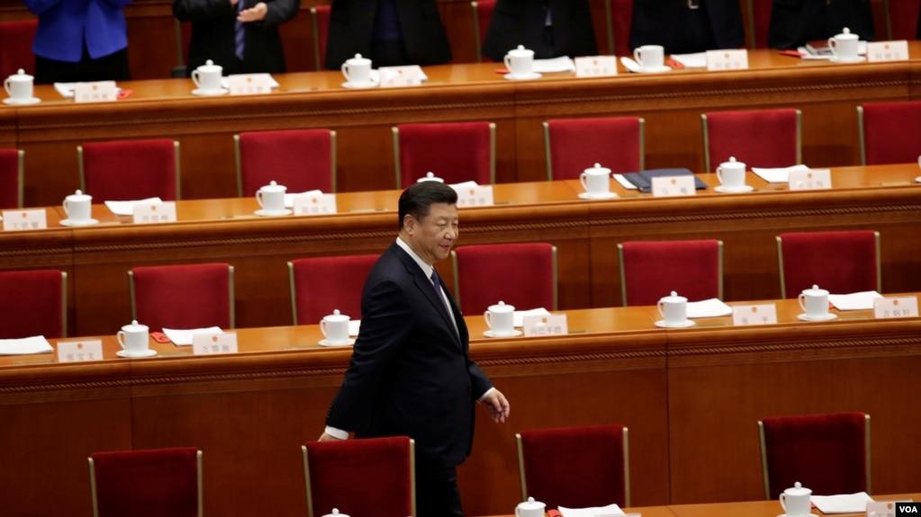 中国国家主席习近平抵达北京人大会堂参加宪法修正案的投票表决。(2018年3月11日)