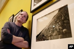 "Dennis McNally stands by a photograph of the ""Human Be-In"" at the exhibit ""On the Road to the Summer of Love"" in the California Historical Society in San Francisco."