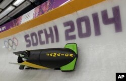 The JAM-1 sled from Jamaica, takes a turn during a training run for the men's two-man bobsled at the 2014 Winter Olympics, Feb. 6, 2014, in Krasnaya Polyana, Russia.