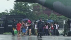 In Manila, Flights Depart with Typhoon Aid, Return With Survivors