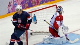 USA forward T.J. Oshie scores in shootout against Russia during men's ice hockey matchup at the 2014 Winter Olympics, Sochi, Feb. 15, 2014.