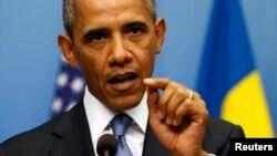 Tổng thống Mỹ Barack Obama nói về vấn đề Syria trong cuộc họp báo chung với Thủ tướng Thụy Điển Fredrik Reinfeldt tại Stockholm, Thụy Điển, ngày 4/9/2013.