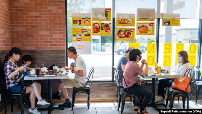 People eat at the Red Chicken Thai restaurant as Los Angeles County moves into life up restrictive coronavirus disease (COVID-19) disease reopening tier, in San Gabriel Valley, California, U.S., June 15, 2021