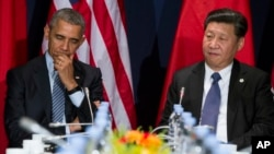 FILE - U.S. President Barack Obama, left, has directly discussed concerns about China's pending anti-terrorism law with the country's leader, Xi Jinping. They're shown during a meeting in Paris, Nov. 30, 2015.