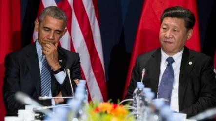 美国总统奥巴马(左)和中国主席习近平在联合国气候大会上(2015年11月30日)