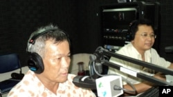 """From left to right: Mr. Sum Rithy, civil party complainant for case #002, and Mr. Lat Ky, tribunal monitor chief of ADHOC, on 'Hello VOA""""."""