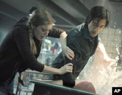 "SARAH POLLEY as Elsa Kast and ADRIEN BRODY as Clive Nicoli in Warner Bros. Pictures' and Dark Castle Entertainment's science fiction thriller ""SPLICE,"" a Warner Bros. Pictures release."
