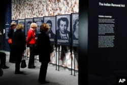 "People look at a section of the ""Americans"" exhibit that explores the historical context of the Trail of Tears, at the Smithsonian's National Museum of the American Indian, Friday, Feb. 9, 2018"