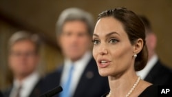 Angelina Jolie, in her role as U.N. envoy, talks during a news conference regarding sexual violence against women in conflict, during the G8 Foreign Ministers meeting in London, April, 11, 2013.