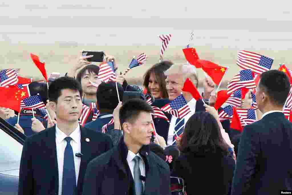 U.S. President Donald Trump and first lady Melania Trump arrive at Beijing airport, China.