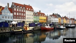FILE - Boats are anchored in the Nyhavn district of Copenhagen, Denmark, Dec. 5, 2009. Global watchdog Transparency International said Wednesday its latest annual Corruption Perceptions Index report Denmark and New Zealand performed best in 2016, with scores of 90.