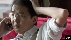 FILE - Attorney Xia Lin, pictured on July 14, 2011, was sentenced to 12 years in prison, Sept. 22, 2016, on fraud charges in what observers said was thought to be the harshest penalty rendered in years against those few willing to take on the ruling Communist Party.