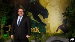 "Director Jon Favreau poses for photographers upon arrival at the European premiere of the film ""The Jungle Book"" in London, April 13, 2016."