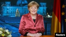 German Chancellor Angela Merkel concludes the recording of her New Year's speech in the Chancellery in Berlin, Dec. 30, 2014.
