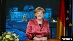 Almanya Başbakanı Angela Merkel Yeni Yıl konuşmasını yaparken