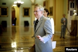 U.S. Senate Majority Leader Mitch McConnell, R-Ky., greets staff members at the U.S. Capitol in Washington, Sept. 8, 2015. Three more Democratic senators announced they would back the Iran nuclear deal.