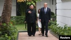 North Korea's leader Kim Jong Un and U.S. President Donald Trump talk in the garden of the Metropole hotel during the second North Korea-U.S. summit in Hanoi, Vietnam, Feb. 28, 2019.