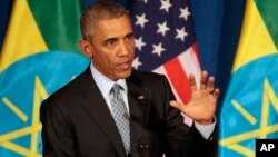 U.S. President Barack Obama gestures during a joint press conference with Ethiopian Prime Minister Hailemariam Desalegn at the National Palace in Addis Ababa, July 27, 2015.
