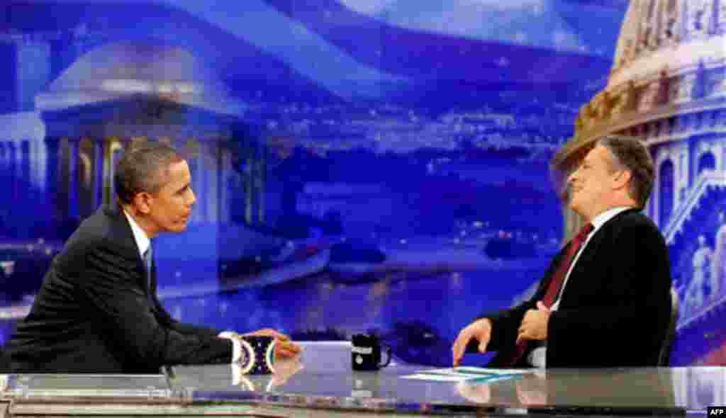 President Barack Obama is pictured during a commercial break as he talks with host Jon Stewart as he takes part in a taping of Comedy Central's The Daily Show with Jon Stewart, Wednesday, Oct. 27, 2010, in Washington. (AP Photo/Charles Dharapak)
