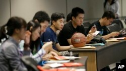 FILE - Weikang Nie, a finance graduate student from China, attends a new student orientation at the University of Texas at Dallas in Richardson, Texas Aug. 22, 2015. (AP Photo/LM Otero)