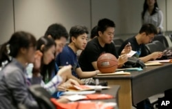 FILE - Chinese students attend a new-student orientation at the University of Texas at Dallas in Richardson, Texas, Aug. 22, 2015.