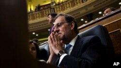 Penjabat Perdana Menteri Spanyol, Mariano Rajoy, menghadiri sidang parlemen Spanyol di Madrid (19/7). (AP/Francisco Seco)