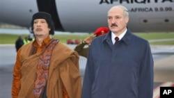 Belarusian President Alexander Lukashenko, right, and Libyan leader Moammar Gadhafi seen during a welcome ceremony in Minsk, Belarus, Saturday, Nov. 2, 2008