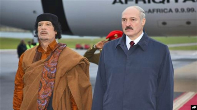 Belarusian President Alexander Lukashenko, right, and Libyan leader Moammar Gadhafi seen during a welcome ceremony in Minsk, Belarus, Saturday, Nov. 2, 2008