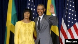 U.S. President Barack Obama stands for a photograph with Jamaica's Prime Minister Portia Simpson Miller upon his arrival at Jamaica House in Kingston, April 9, 2015.