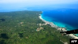 Wilayah pesisir Kota Jolo, Provinsi Sulu, Pulau Mindanao di selatan Filipina, yang menjadi basis kelompok militan Abu Sayyaf, 31 Agustus 2016. Kementerian Luar Negeri RI memastikan lima nelayan WNI diculik kelompok Abu Sayyaf pada 16 Januari 2020.