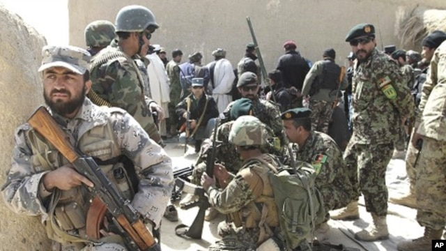 Afghan security forces are seen after Taliban militants opened fire on delegation of senior Afghan officials in Panjwai, Kandahar province in southern Afghanistan, March. 13, 2012.