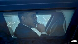 FILE - U.S. President Barack Obama is seen in an armored vehicle. Obama is meeting with the top Republican congressional leaders on Feb. 2, 2016, to see if they can reach accord on 2016 legislative goals.
