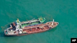 FILE - This May 24, 2018, photo released by Japan's Ministry of Defense shows North Korean-flagged tanker SAM JONG 2, bottom, alongside MYONG RYU 1, a vessel of unknown nationality, in the East China Sea. Japan's Foreign Ministry said a Japanese navy surveillance aircraft spotted a suspected unidentified ship apparently transferring fuel to a North Korean tanker in the open seas.