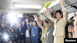 Yuriko Koike (R) and her supporters celebrate her win in the Tokyo Governor election in Tokyo, Japan, in this photo taken by Kyodo, July 31, 2016.