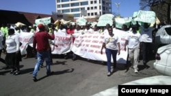 FILE: Workers of the National Railways of Zimbabwe staging peaceful protests in Zimbabwe's second largest city, Bulawayo.